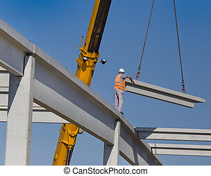 Height worker placing truss on building skeleton -...