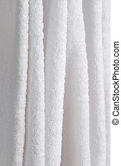 Abstract close up of hanging white towels
