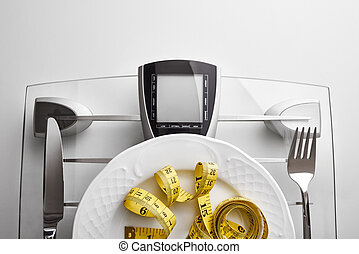 Concept healthy food on table closeup - Cutlery with yellow...