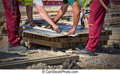 Worker preparing plank for cutting - Close up of worker's...