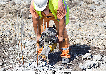 Worker with jackhammer - Construction worker holding...