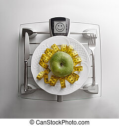 Concept healthy food on table with apple and face message -...