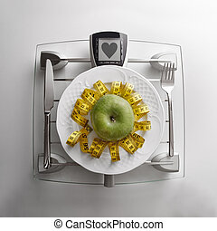 Concept healthy food on table with apple and heart message -...
