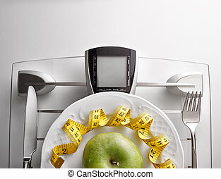 Concept healthy food on table with apple close up - Cutlery...