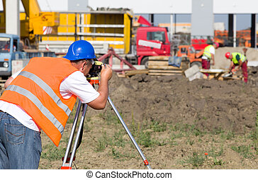 Worker with theodolite - Surveyor engineer working with...