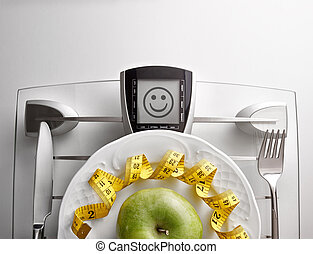 Concept healthy food on table with apple face message...