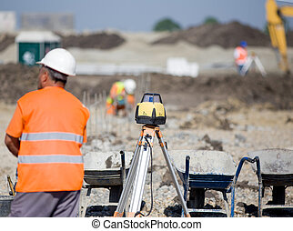 Surveying equipment at construction site