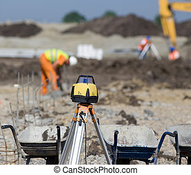 Surveying equipment at construction site - Rotating laser...