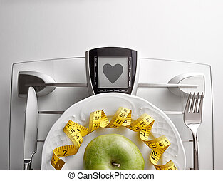 Concept healthy food on table with apple heart message...