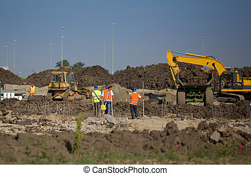 Road construction - Construction workers measuring ground...