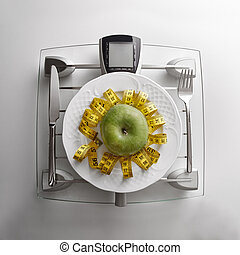 Concept healthy food on table with apple - Cutlery with...