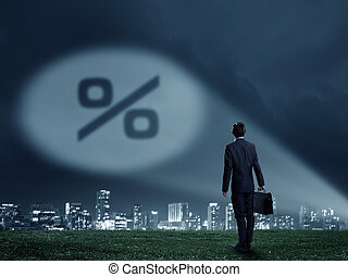 Best interest rate - Businessman standing with back and...