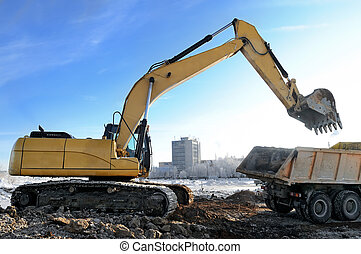 loader excavator loading a rear-end tipper - Loader...