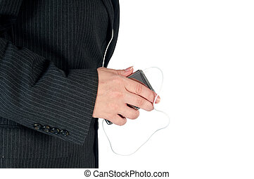 Horizontal image of a female business person with a portable music player