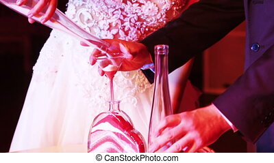 Sand at wedding ceremony - Newlyweds do ritual ceremony of...