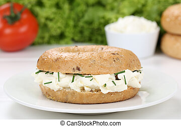 Bagel with cream cheese for breakfast - Bagel with cream...