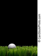 Vertical image of a white golf ball in green grass on a...