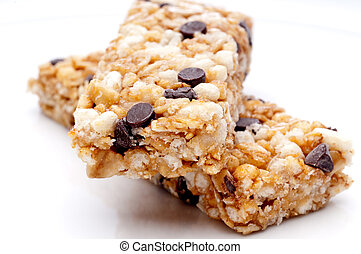a horizontal close up of two granola bars on a white plate