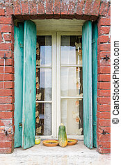 Window of a farmhouse with red brick frame - Window of a...