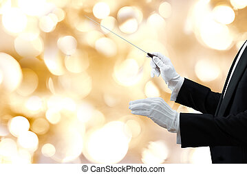 Music Conductors Hand Holding Baton - Cropped image of music...