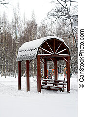 Alcove in winter - Alcove covered with snow in park during...