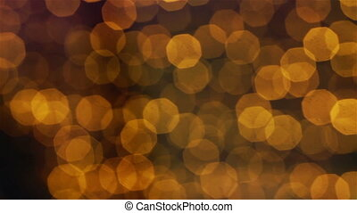 Yellow brown bokeh lights moving in a slow and calm way