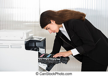 Businessman Fixing Cartridge In Photocopy Machine At Office...
