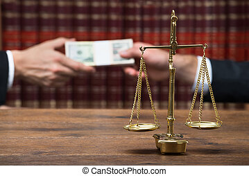 Justice Scale On Table With Judge Taking Bribe From Client -...