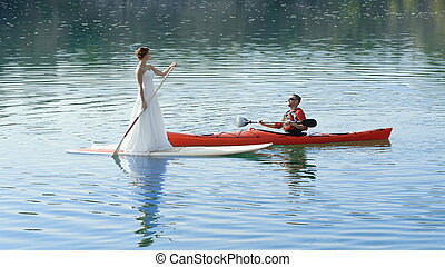 happy couple on vacation sport kayak SUP newlyweds - Stand...