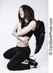 Fallen angel over grey background