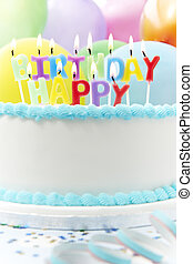 Celebration Cake With Candles Spelling Happy Birthday
