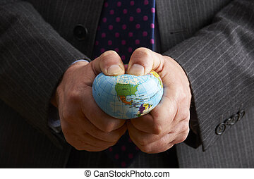 Businessman Squeezing Globe Over North America