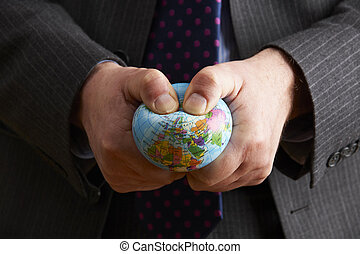 Businessman Squeezing Globe Over Europe And Africa
