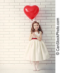 girl with red heart - Sweet child girl with red heart. Happy...