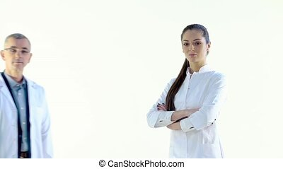 Doctor Approaches Nurse in White Studio, They Look at the...