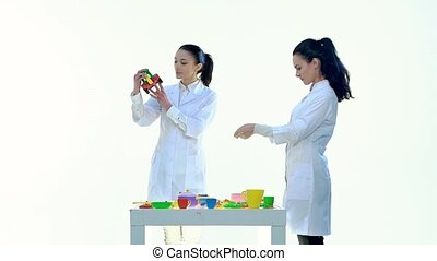 Womens in Laboratory Check Quality of Plastic Toys in White...