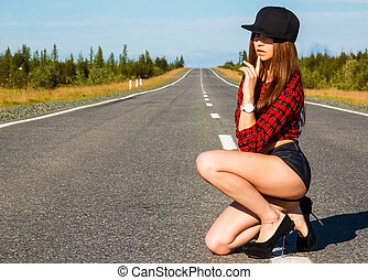 Sexy woman in a checked shirt on the road - Sexy woman in a...