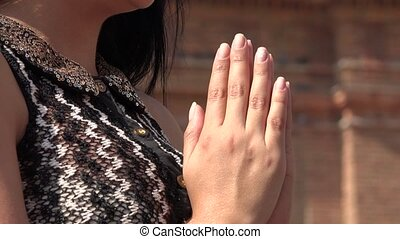 Young Hispanic Woman Praying