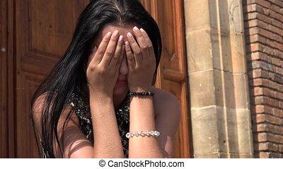 Young Hispanic Woman Crying