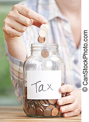 Woman Dropping Coins Into Jar Labelled Tax