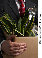 Redundant Businessman Carrying Possessions In Box