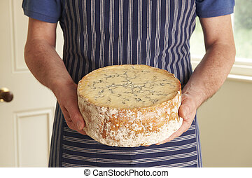 Grocer Holding Shropshire Blue Cheese