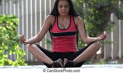 Fit Young Woman Meditating