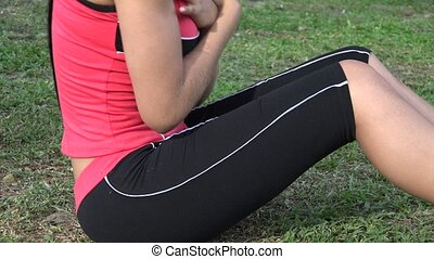 Fit Young Woman Doing Situps