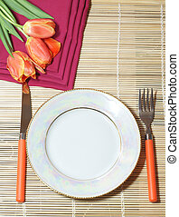 Holiday dinner - White plate and orange covers with tulips