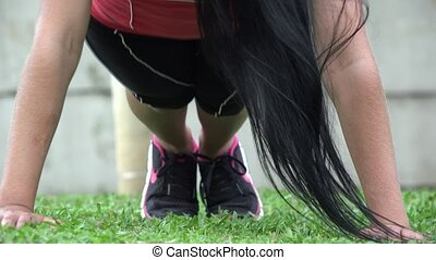 Young Athletic Woman Doing Pushups