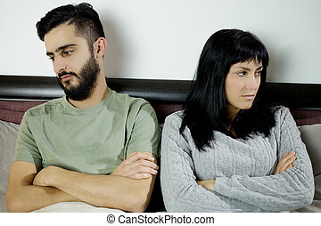Unhappy couple after fight in bed not talking - Young couple...