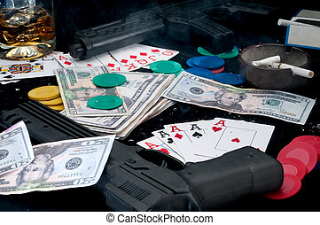 Guns and cards on a table - cheating at gambling