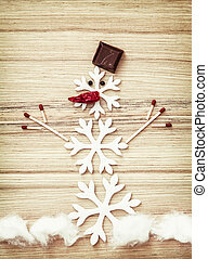 Beautiful snowman of snow flakes, matches, chocolate and...