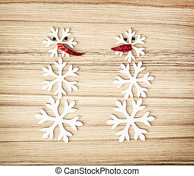 Two snowmen made of snow flakes and chili peppers, symbol of...